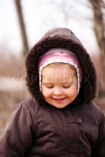 Happy nice baby in autumn park portrait