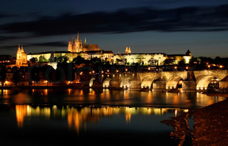 View on famous Charles Bridge and Castle illuminated at evening in Prague, Czech Republic