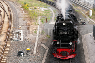 Close-up steam train from above