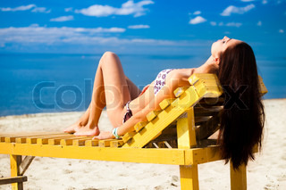 Young woman relaxing on the sea beach