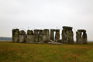 Famous Stonehenge in a foggy winter day