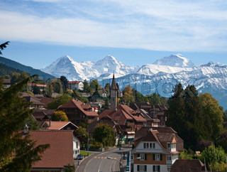Typical swiss village with snowy peaks
