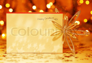 Beautiful gold happy Christmas card,winter holiday background, decoration postcard with snowflakes abstract over defocus lights