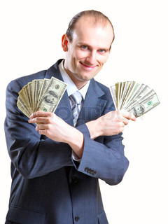 Cheerful man holding dollars in his hands
