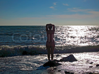 Naked woman on the seashore