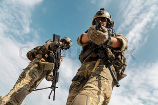 us army rangers pointing weapons to the camera detaining person low
