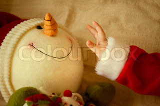 Children's hand stretches to the Christmas toy