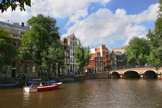 View on Amstel river (city canal) and historic houses in Amsterdam, Netherlands (Holland)