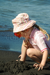 A small child is playing at the beach