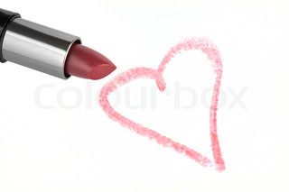 Lipstick and heart on paper