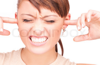picture of unhappy woman with fingers in ears