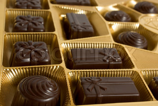 Box of chocolates inside Dark chocolate in gold foil