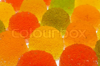 background of green, yellow, orange and red fruit candyes