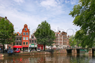 Streets, houses and city canal in Amsterdam, Netherlands