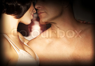 Happy couple kissing, love, romance, passion, relationship of two young beautiful adult people