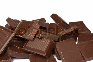 heap of chocolate fragments on a white background it is isolated