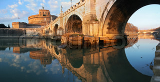Panoramic view on famous Saint Angel castle and bridge over the Tiber river in Rome, Italy
