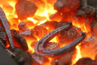Closeup of a horseshoe in a forge