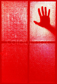 Blurred silhouette of a hand behind a window or glass door, all in the red color (symbolizing horror or fear)