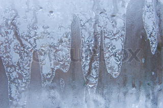Frostwork on a window glass (as an abstract winter background)