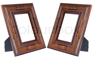 Two dark brown wooden photo frames isolated on white (with empty space for your text, photo or picture)