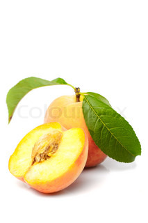 Peach with green leaves from tree isolated on white background