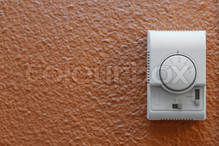 White air conditioning control panel on wall in a hotel room