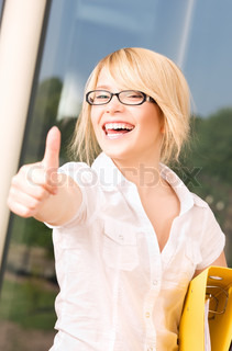 bright picture of young businesswoman in office