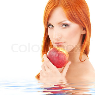 redhead woman with red apple in water