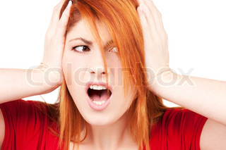 picture of unhappy redhead woman with hands on ears