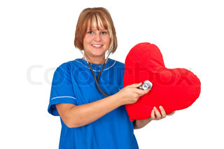 Young nurse with stethoscope and red heart - isolated