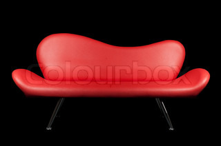 Red sofa on black background isolated for you