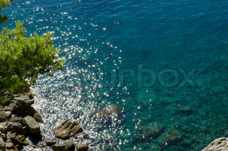 View of the Adriatic sea from above with sunshine stars in the water