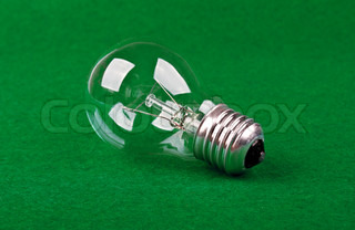 one bulb lamp on a green tissue background