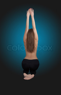Classic low-key photo of sexy woman back, on blue background