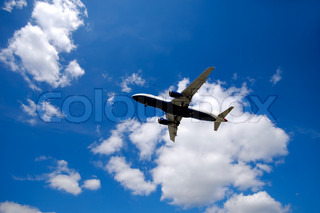 Blue and cloudy sky and airliner