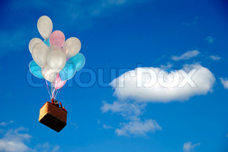 Helium balloons is lifting basket with people