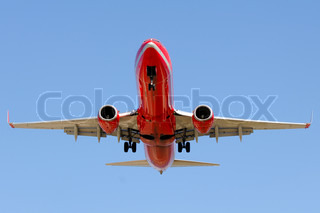 Red plane is going to land