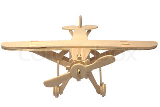 Wooden model of the plane on a white background it is isolated