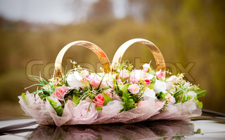 Wedding symbols - bunch of flowers and couple of rings