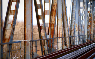 Rusty old bridge and abandoned railroad tracks