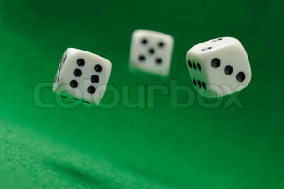 Game cubes on a green background