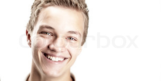 A close-up shot of a boy smiling, isolated on white