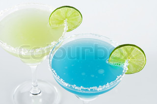 Classic margarita and blue margarita alcohol cocktails (top view) isolated on white background