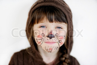 Cute little girl with face painted wearing knit brown hood