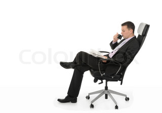 Businessman talking on the phone sitting in a chair in a bright office Isolated on white background