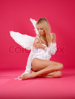 picture of lonely angel girl over pink