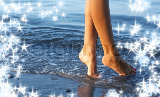 legs in water surrounded by snowflakes and twinkles