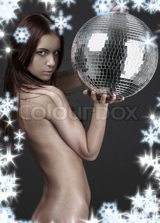 christmas picture of muscular naked girl with glitterball over grey