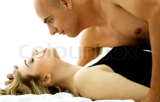 color image of sweet couple cuddling in bed